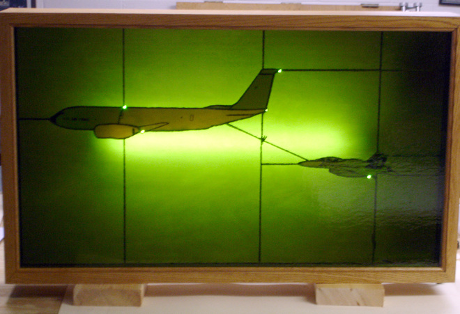 Gary Elshoff created this stained glass window of Jeff McLean in his Navy F/A-18 (right) getting refueled in air by a KC-135 piloted by his wife, Christine McLean. The original photo ran on the front page of the Journal Sentinel on July 2, 2010.   GARY ELSHOFF PHOTO