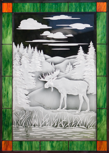 Completed 2010. One of several window panels we made for new home in New York near Lake Erie. Etched & sand-carved glass with colored glass borders.